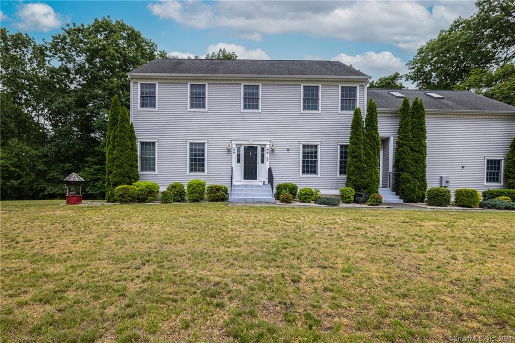 Beautiful spacious colonial located in a private setting tucked back from the road. Chef's kitchen w/granite counters, stainless steel appliances, center island, & wine fridge. Opens to the family room w/fireplace & sliders to the deck. Formal living room & family room. Large mudroom located off the kitchen. On the 2nd floor you will find the master suite complete w/walk in closet and full bath w/whirlpool. 3 additional bedrooms & a home theatre + laundry area complete the 2nd floor.  The fully finished w/o lower level makes a great rec room, gym, and so much more.  There is also a private office in the lower level. Central air, generator hook up. Relo addendums required.