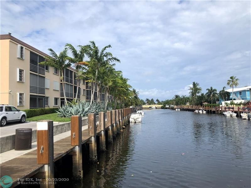 ***Memorial Day Special***  Least expensive 2/2 condo in prestigious Lighthouse Point that offers immediate boat dockage and all ages welcome! Boats are limited to 25' and one fixed bridge with high tide clearance of approximately 6'. Rental rate at $3/ft. Snowbirds took flight, so unit is ready for the summer. Garden view of the prettiest tree in LHP, and only steps to the community dock or heated pool from the back, screened porch. Short bicycle ride to the promenade at Deerfield Beach. Bedrooms have impact resistant windows. Extra onsite storage. Sorry, no commercial vehicles.
