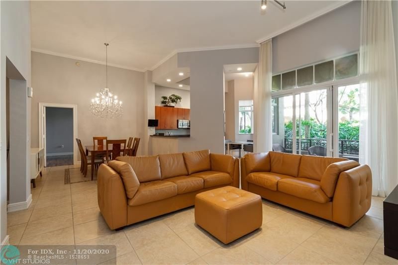 Price just reduced on this stunning 1st floor corner unit in main Clubhouse building of luxurious 55+ resort style community, The Palms at Weston.Two spacious bedrooms, large den, soaring 13' ceilings, two private patios.Tastefully upgraded and freshly painted, 20x20 tile in main living areas, wood flooring in bedrooms. Remodeled kitchen, inside laundry room & plenty of storage. Largest open floor plan in The Palms. Within steps from all the amenities including swimming pool, fitness center, restaurant, card room, library, beauty salon, mailbox, and health clinic. Easy walk to grocery store, banks and restaurants and a 5 minute drive to Cleveland Clinic. Maintenance includes a $180/quarter credit for on site restaurant and a deeded double storage unit.