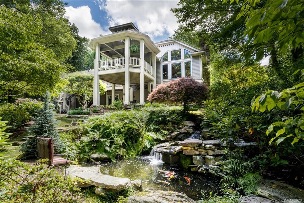 The ultimate in luxurious mountain living. A hallmark of design and quality with total privacy situated on 1.95 gorgeous landscaped acres in prestigous Kenmure-a gated golf course community. This breathtaking home has everything you would want and more with mountain and man-made cascading stream and waterfall views, an open floor plan, state of the art expansive kitchen and great room that opens seamlessly to the grand outdoor living space. Main level boasts oak hardwood floors w/ black walnut inlays, beamed & coffered ceilings, library, DR, great rm w/ stone FP, upscale kit w/ island & butler's pantry, luxurious master suite, expansive laundry room/hobby rm & mud rm. The LL features a family rm, billiard area, full bar, card rm & 2 guest suites. Outdoor living options include the gazebo-style covered deck, open deck, stone patios, cascading waterfall w/ Koi pond & lush landscaping. Add'l features- 3 car plus golf cart garage & generator. Close to gate & amenities. Truly Spectacular!
