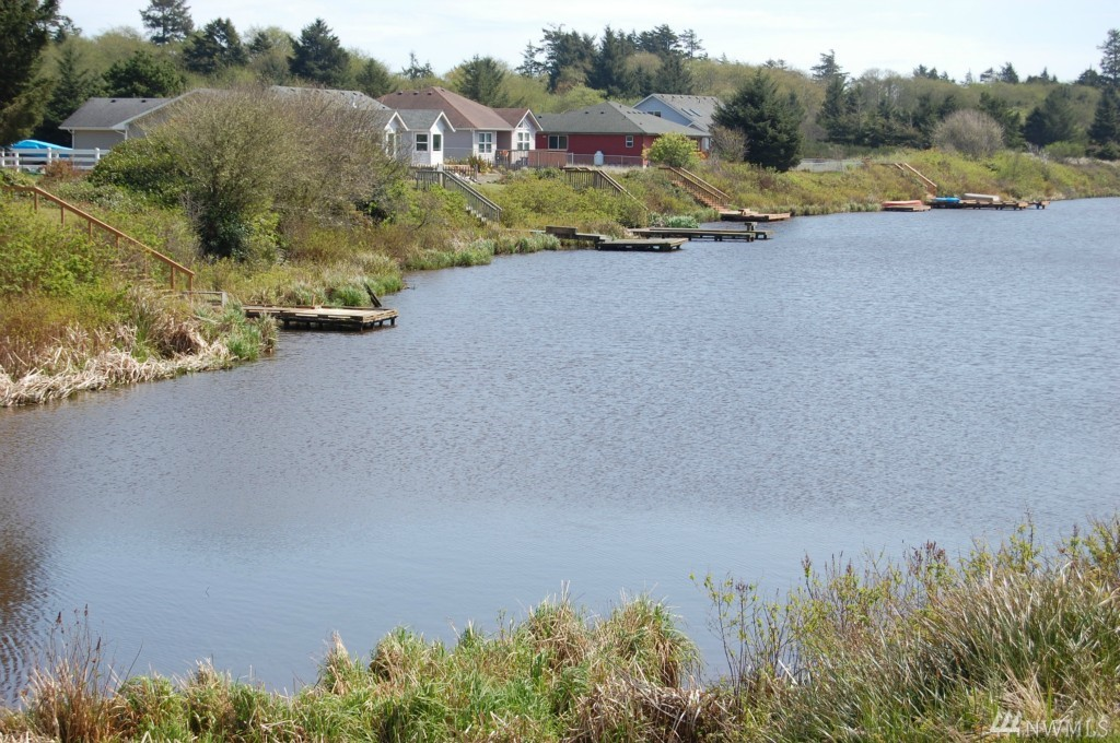 Awesome lakefront property at an excellent low price. This is your opportunity to have a Duck Lake frontage home or camping site. Close to everything yet very peaceful and quiet location. You can ride your bike to the beaches, parks, golf course, downtown shops and restaurants and nature trails. Property comes with all utilities in the street and ready for hookup. Sewer LID Paid in Full!