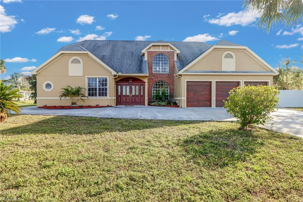 Nothing Compares   You can't get more bang for your buck, per square foot, than with this South Florida property! This home is one of the lowest priced single family pool homes available and with nearly 4,000 square feet, you have plenty of options for its future use. It could be a nice rental, a large family home, or a winter retreat. The home sits on a large corner lot, with circular drive, close to nearly everything you could need (dining, shopping, pharmacies, and I-75). The two story home has soaring ceilings in the living area while also giving you plenty of room to spread the family out. There are two bedrooms and two baths on each floor. One master on each floor. There is a den/office on the second floor as well. The bathrooms look great and most of the fixtures are new. The guest bedroom upstairs features a drop-shoot for the laundry room on the first floor. The kitchen is very nicely done and there is no carpet in the home. The large pool deck is great for family gatherings. The pool was recently re-surfaced. The owner added a nice 6' high fence on the property for extra privacy.