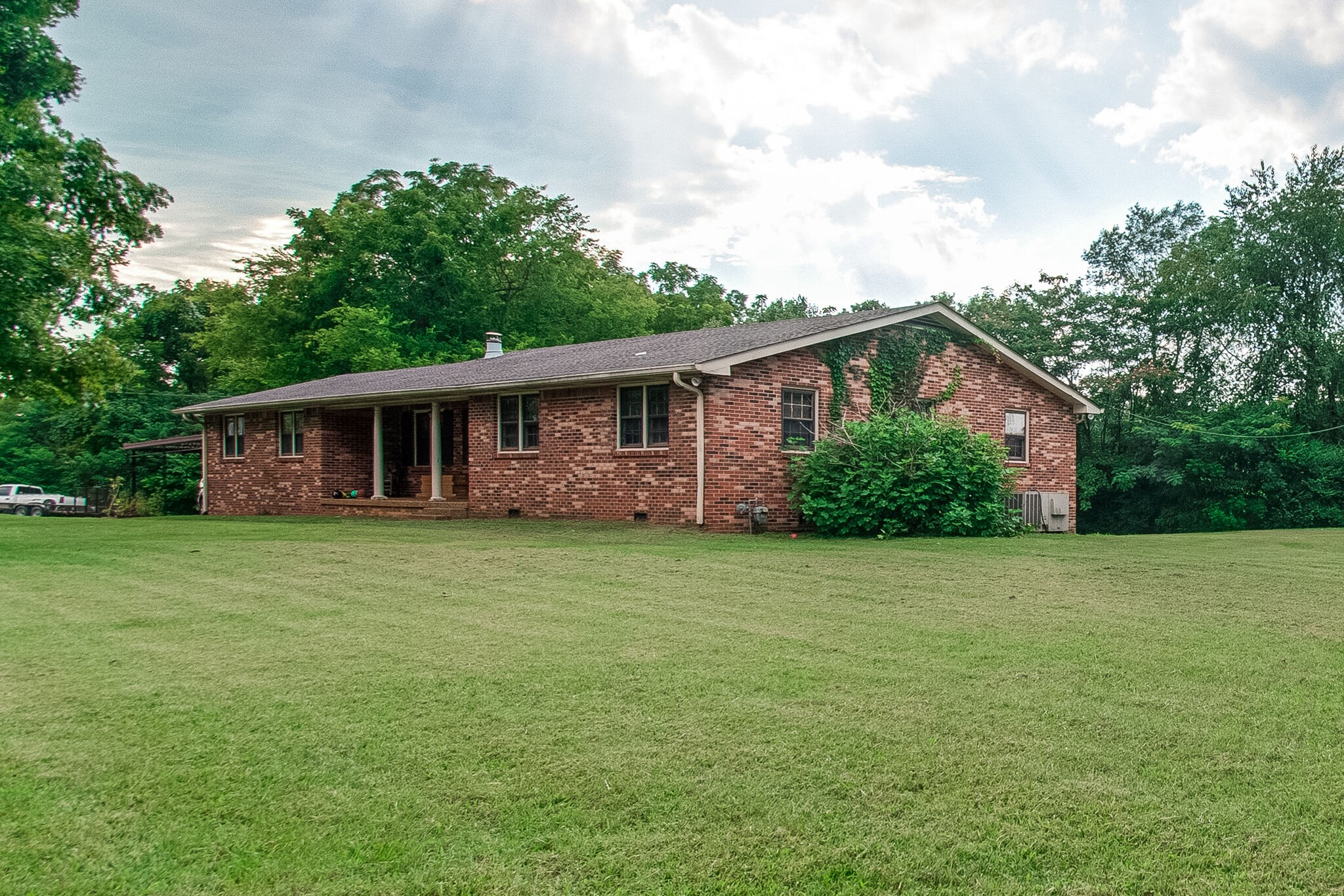 A POTENTIAL COMMERCIAL PROPERTY! A house with approx.1.5 acres of flat land. It is currently under rent. The lease ends July 2021 and it comes with the purchase. Beautiful 1984 built large brick ranch home w/ 2 car carport. Large kitchen and bonus room. This house is located in the center of Fairview surrounded by many commercial businesses (restaurants, banks and Walmart). This can be rezoned to build multi residential units or commercial income producing assets. Buyer to verify all MLS info