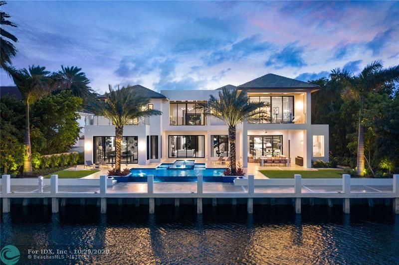 NEW CONSTRUCTION HOME. FINISHED AUGUST 2020 Waterfront estate designed by renowned architect Randall Stofft and built by Trilogy Construction. This home marries a modern aesthetic with organic finishes to exude elegance and warmth. This 8,273 SF AC estate features a lavish master suite with dual master baths and closets. This furnished estate provides extraordinary amenities, including spacious clubroom with wet bar, elevator, 7-seat theater, 560 bottle wine room & pet grooming area. Chef's double island kitchen includes Miele & Wolf appliances. Located in Harbor Beach, a private beach club community, this modern estate is situated on one of the most sought-after streets. The oversized lot offers 105' WF on an ultra-wide canal. Summer kitchen, outdoor dining and infinity pool.