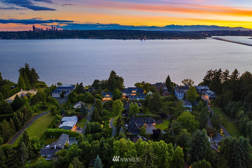 Never before available, this extraordinary street-to-water estate is comprised of 2 lots totaling over 2 acres of west-facing Medina waterfront offering 180-degree views of the lake, mountains & Seattle skyline. Over 9,500sf of spacious, classically styled interiors incl. wonderful entertaining spaces, an indoor pool, 2 guest apts & more. At the water's edge, a cabana w/kitchen & bath, 172ft of private waterfront, & one of the best docks on the Lake. A once-in-a-lifetime opportunity in Medina.
