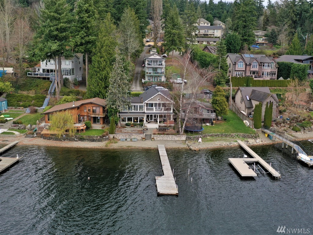 Beautifully redesigned -every detail of this distinctive waterfront Lake Sammamish home has been artfully curated in the 2015 remodel. Quality finishes- sumptuous hand scraped hardwood floors, shiplap ceilings, distressed wood accents, designer light fixtures & more! Enjoy the gourmet kitchen w/ SubZero refrig & full size freezer, huge walk-in pantry & gorgeous views! With 58 Ft of prime low bank Gold Coast waterfront, covered patio w/ built-in BBQ &  dock& boat lift – you're ready to entertain!