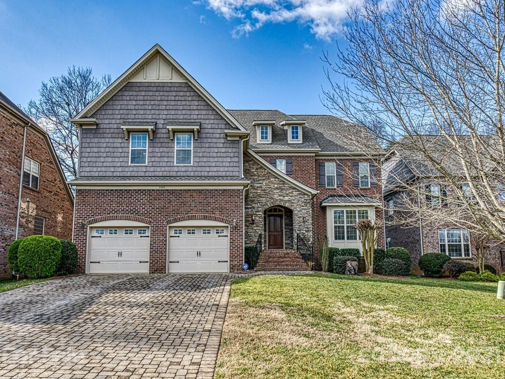 "Beautiful full brick home w/stone accents & loads of upgrades on a deep, level & private lot. HW floors thru out main level, except BD 4, HW stairs & HW's in upstairs hallways. Generous trim, mouldings & baseboards thru out. Grand 2 sty foyer. Formal DR & LR plus spacious GR w/stone FP. Gourmet kit w/granite tops, island, 42"" stacked cabinets, some w/glass fronts, SS appliances including 6 burner gas cooktop. Main level guest suite/office w/adjoining full BA. Huge master suite w/sitting room w/a FP, bench seat & built-ins.  Master BA has tile floor, garden tub, separate shower, dual vanities & oversized walk-in closet with built-ins. Secondary BR's are large w/plenty of closet space. Enormous bonus rm w/built-ins. Built in speakers in multiple locations. 2 car garage w/overhead storage & drop zone leading into the house. Brick paver driveway and rear patio. Back yard is perfect for adding a built-in pool. Prime location near Arboretum, Waverly, Ballantyne, Uptown w/outer belt access."