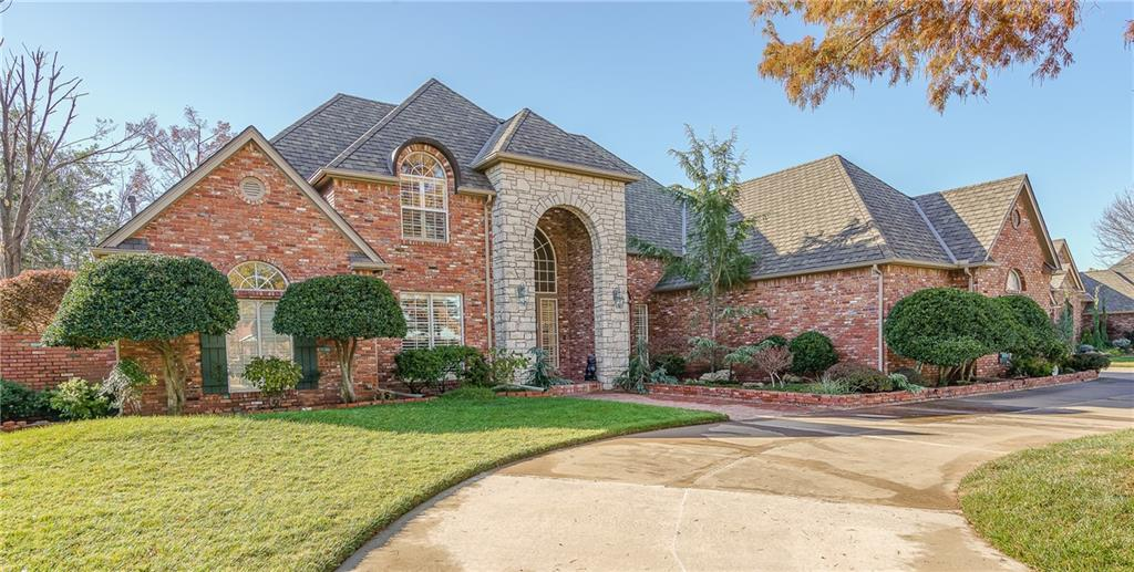 Spectacular LAKEFRONT Home in Gated Community Boasts Stately ARCHITECTURE & Quality DETAILS; Brick from Bricktown, OKC ~ Stellar Landscaping on .35 Acre with Exceptional Curb Appeal ~ Your Backyard Oasis is PEACEFUL & SERENE Overlooking the Water ~ EXQUISITE Grand Entry with Spiral Staircase, Soaring Ceiling & STUNNING Chandelier ~ PLANTATION Shutters throughout ~ All New Appliances in 2019 which includes Built-in Refrigerator ~ Study has BEAUTIFUL Inlay Wood Ceiling with Wood Floors ~ 2nd Living & Kitchen has Gorgeous Wood Floors ~ HUGE Master En-Suite has Private Patio, Marble Whirlpool Tub, Separate Shower, Double Vanities & Ginormous Walk-in Seasonal Closet with Built-ins ~ Wet Bar with Ice Maker ~ Italian Marble Fireplace in Formal Living Room ~ 3 LARGE Guest Bedrooms Upstairs, one could be Jr Master + Hobby Room with Large Walk-in Closet ~ Large Balcony off Guest Bedroom Overlooking the Water ~ 3 HVAC less than 5 yrs old & 2 50 Gallon HWT in 2017! Welcome Home!