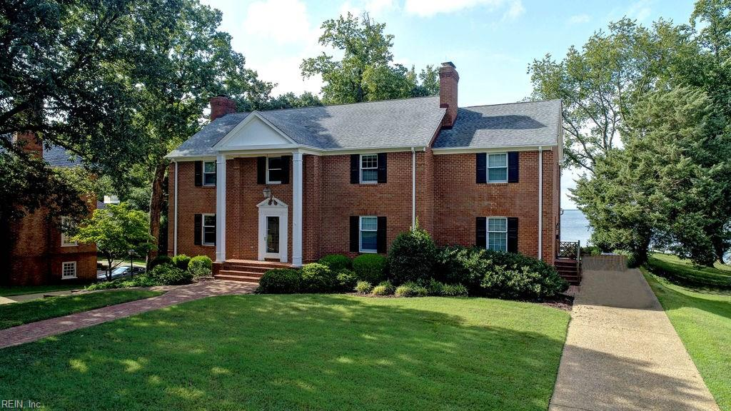 GRAND JAMES RIVER WATERFRONT ESTATE FEATURING XLARGE LARGE ROOMS,TALL CEILINGS,FIVE BEDROOMS,THREE CAR GARAGE AND PLENTY OF ROOM TO GROW.THIS ONE HAS IT ALL AND IS WAITING FOR A NEW OWNERS SPECIAL TOUCH.LARGE ENTRANCE FOYER,OVERSIZED LIVING ROOM,FORMAL DINING ROOM,LARGE CENTER ISLAND EAT IN KITCHEN,VAULTED SUNROOM,HOME OFFICE OR LIBRARY AND BASEMENT GREAT ROOM.........EVERYTHING IS LARGE HERE IN THIS BRICK 5000 SQ FOOT ONE OWNER HOME.FIVE BEDROOMS,FOUR AND HALF BATHS.MASTER SUITE BOASTS HIS AND HER BATHS.LOWER LEVEL WITH FAMILY ROOM.ALL THIS PLUS GLEAMING WOOD FLOORS THROUGHOUT,TWO FIREPLACES,ELEVATOR,REAR LOADING THREE CAR GARAGE,WORKSHOP AREA AND WALK UP ATTIC WITH PLENTY OF FLOORED STORAGE.LEVEL RIVERFRONT LOT WITH BULKHEADED SANDY  BEACH AND PIER.ENDLESS POSSIBILITIES COMBINE WITH PANORAMIC JAMES RIVER SUNSETS.