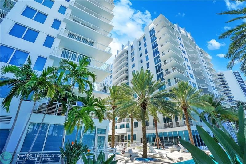 Motivated Seller, 2 parking spaces & pet friendly contemporary 5 star building with amazing amenities. The updated unit boasts Ocean, Intracoastal & Pool views, 2/2 split floor plan + den, W&D. New SS LG Smart kitchen appliances, new porcelain tile in living areas, marble flooring in bedrooms, updated master bath, new modern smart lighting, new solar shades in living area, automatic blackout blinds in bedrooms, floating entertainment shelf & wall mounted TV in living area. Amenities: infinity pool, cabanas, spa, gym, juice bar, massage & locker rooms, business center, cyber café, catering kitchen, valet parking, 24-hour security. Fenced Pet Play Area. Marriott Harbor Beach Resort membership included in HOA fee. North side balcony to enjoy outside all year without the hot south side sun.