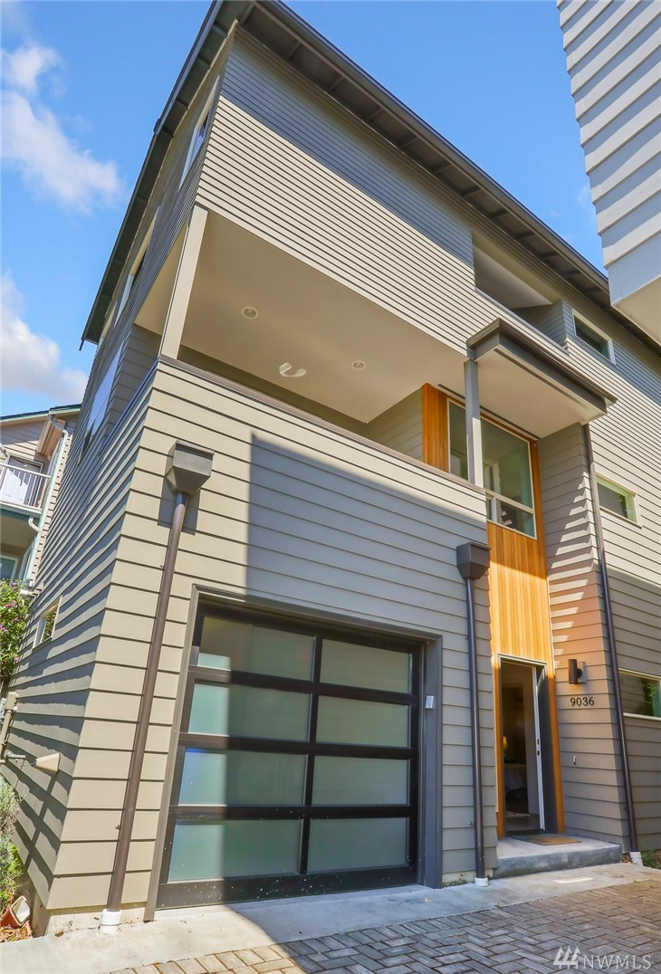 Rare opportunity for newer, freestanding Northwest Contemporary town home with over 1900 square feet and attached garage. Light, bright and open floor plan with vaulted ceilings and very big spaces throughout. Within steps to all the area cafes, restaurants, shops and parks. Very convenient to transit, downtown and South Lake Union. Modern finishes. High, vaulted ceilings and lots of windows offer plenty of natural light. All three bedrooms good size with en-suite bath, two on upper level!
