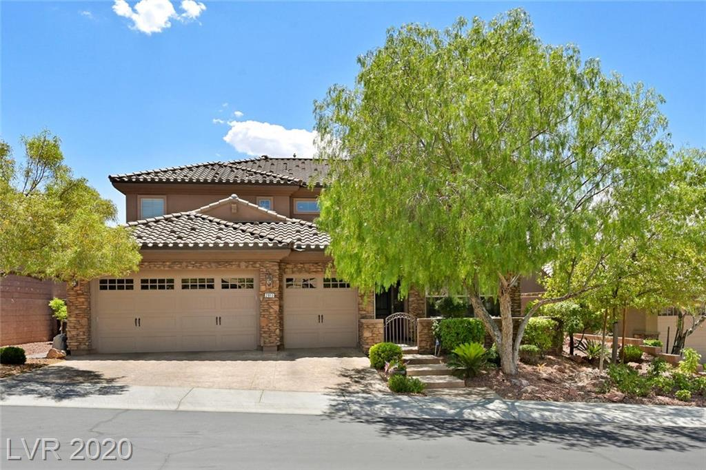Spectacular, Highly Upgraded Madeira Beauty*Elevated lot w/ Balcony Mtn/Strip VIEWS! Dwnstrs Master w/160 Sq Ft Sitting Rm w/Entry to enjoy Resort Style Bckyd w/Solar Htd Pool, Outdr Kitchen, Fire Pit, Drop Shade & TV* 7 TV's are included! Gourmet Kitchen boasts Upgraded Stnls Appliances, Granite Counters, Dbl Ovens, Warming Drawer, Wine Fridge, Island, Brfst Bar & Nook-All Open to Spacious Fmly Rm*Upstairs Dual Master Suites plus 3rd Bdrm & Den*