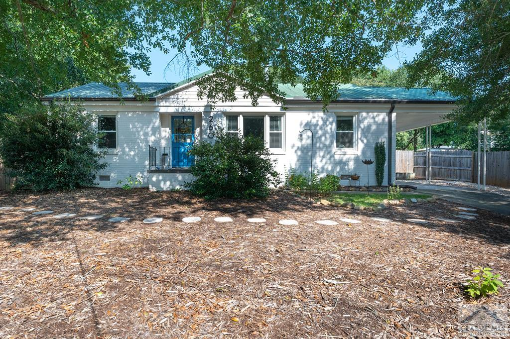 **Price Reduced** Highly sought after Normaltown/General Hospital area four-sided brick ranch is ready for you to make it your home. This 1960's brick charmer was renovated in 2017. The 3 bedroom 1 bathroom house welcomes you with an inviting tree canopy on almost a quarter acre lot that is low maintenance. Once inside the home, the living room is bright and inviting complete with updated doors and windows, and refinished hardwood floors. An arched opening leads you to the dining area and redesigned kitchen. The kitchen boasts an L shaped blonde butcher block countertop complete with island-style seating. There's plenty of storage for dishes and pantry needs in the soft close cabinets. For a real bonus, there's a gas stove and fantastic vent hood,which like the refrigerator and dishwasher are stainless steel. The back wall of the kitchen is an accent wall with reclaimed wood that leads you to the laundry/mud room. The three bedrooms and the bathroom are down the hallway off the living room, and they can be closed off for privacy. The bedrooms each have their own ceiling fan and are spacious. The bathroom has updated features and still maintains the character of the home, including floor to ceiling tile for easy maintenance. Out back you will find a fully fenced backyard with freshly stained detached entertaining deck and loads of native plants. Updates for the home include new exterior paint, gutters, windows, doors, encapsulated crawlspace, additional insulation, landscaping, etc. This location is super convenient to Alps/Beechwood, UGA Health Sciences Campus, Downtown,and Prince Avenue. Don't hesitate to make this house your home! You'll love the location!
