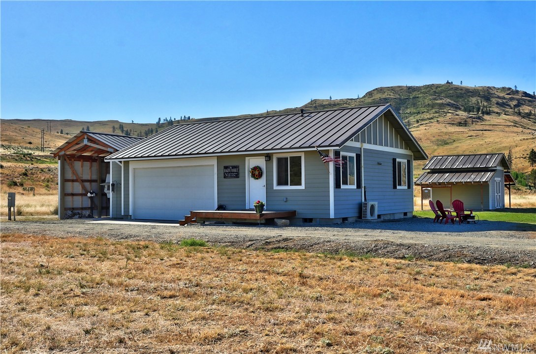 Perfect get-a-way vacation home or live here now, this 392 sf home has just the right touch with quality finishes. 4.40 Acres. RV carport. Barn and shed outbuilding. Large Garage. Irrigation underground sprinkler system. Rugged Mountain views and sunny location all year round! Enjoy the Methow River Ranch gated community. Access to Community Riverfront and beach. Launch your Kayak or go fishing! HOA maintains roads & waterfront Cabana.