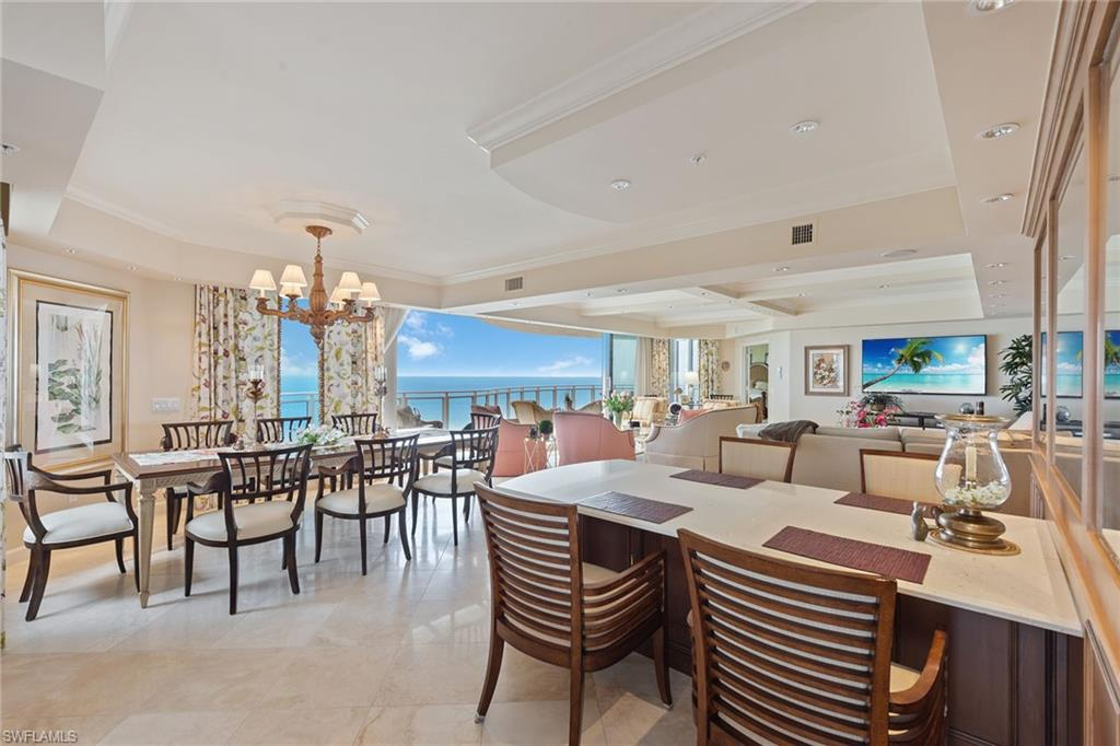 Gorgeous Gulf and beach views. Rarely available, higher-floor end unit directly on the beach in the private gated community of Bay Colony in Pelican Bay. Featuring panoramic views of the Gulf of Mexico through floor-to-ceiling sliding glass door which open onto a spacious wrap around lanai, this highly sought-after floor plan welcomes you into an elegant entry foyer with a spacious living and separate dining area. Open kitchen and den offer plenty of room for entertaining family and guests, along with three full bedrooms, all with en-suite baths. The Brighton amenities include a designer-renovated lobby with a 24-hour manned front desk, guest suites, fitness center, social room and a resort-style pool. Bay Colony residents enjoy the use of their own private renovated beach club and restaurant, a tennis club, as well as the use of the amenities of Pelican Bay. Private golf memberships are available separately.