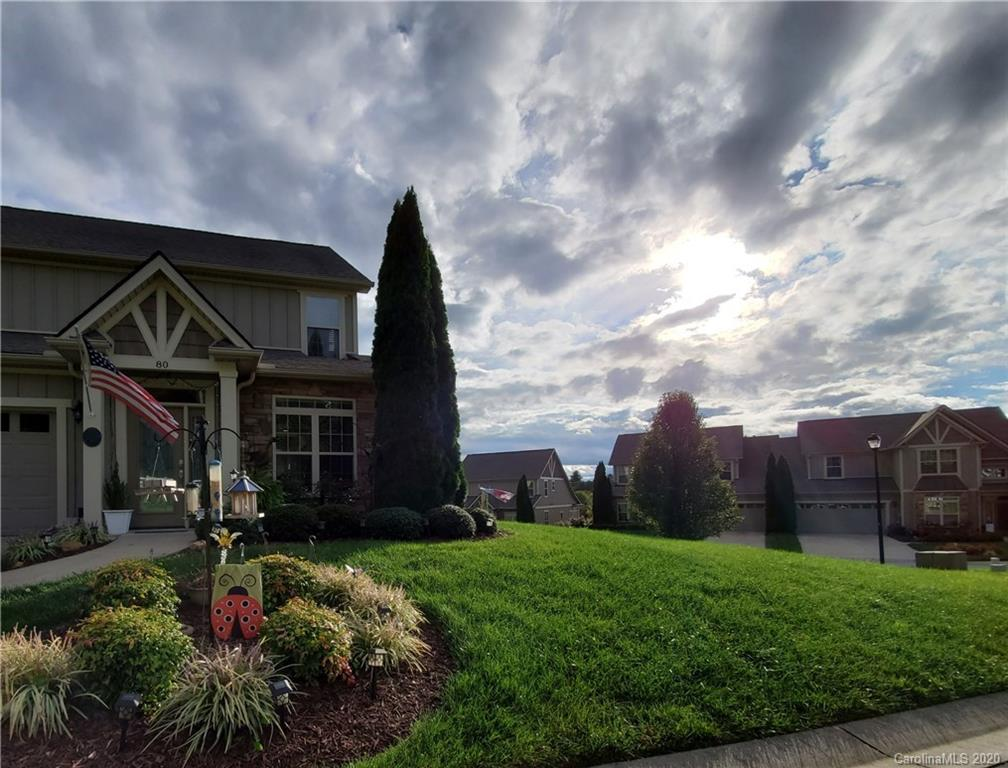 Beautiful, easy-care Lock-N-Go lifestyle! This lovely 2-story townhome boasts HOA maintained exterior and yard maintenance, main level living with updated color scheme and quality finishes throughout. The coveted end-unit home provides extra natural light that pours into the open concept kitchen and living room. In the morning, enjoy your coffee and mountain views from the covered patio and retreat at the end of the day to your spacious master bedroom and completely remodeled master bath with quartz countertops and high-end spa finishes! Other home amenities include granite counters, stainless steel appliances, undercounter lighting, whole-house water filtration system, slow-close cabinets, epoxy garage floor, and many more (see attachment for list). The Village at Windstone is a gated neighborhood with community pool, low HOA; and is convenient to both Asheville and Hendersonville with only a short drive to shopping, restaurants, Ingles grocery store, fitness facilities and healthcare