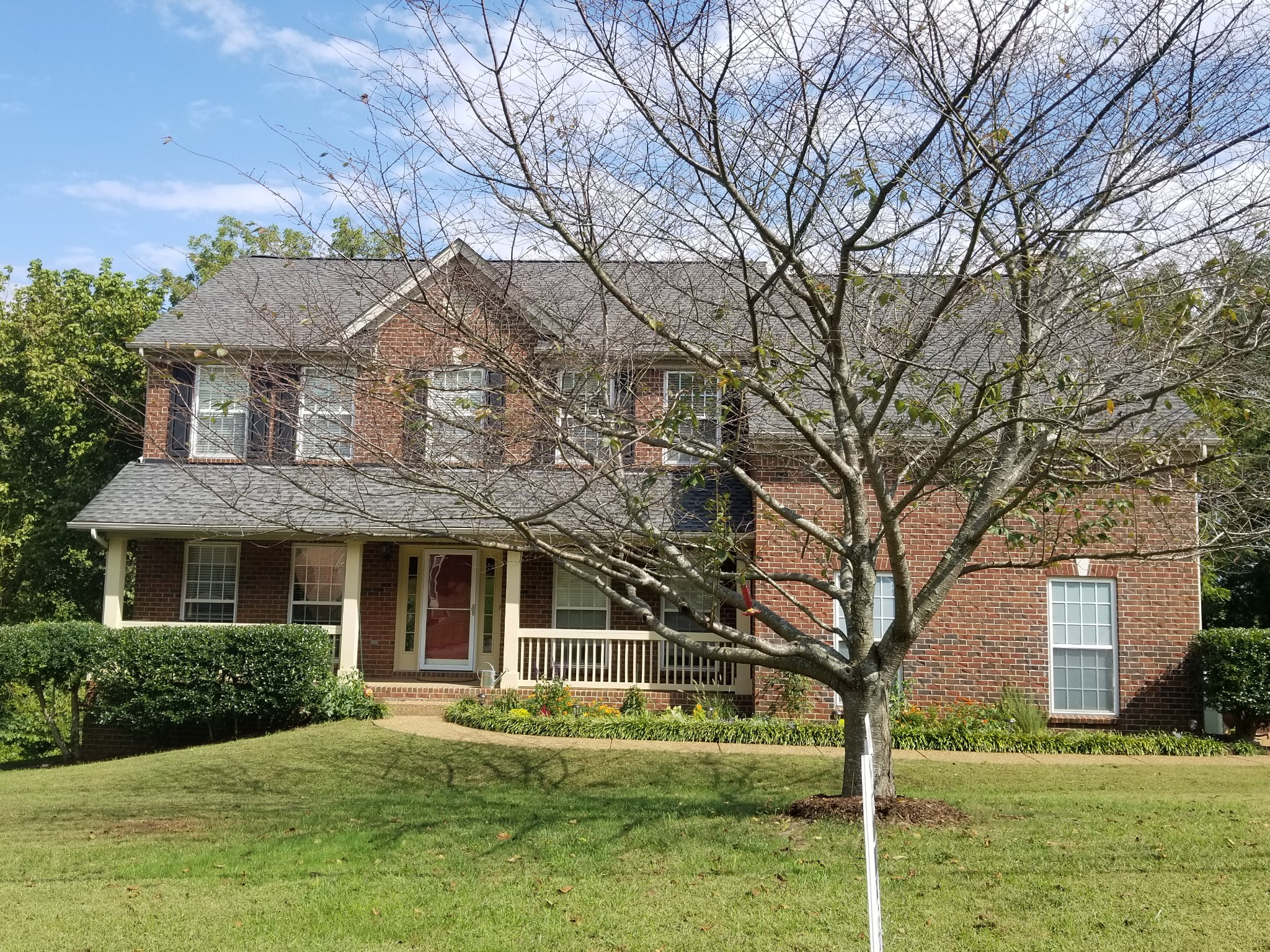 Beautiful 2 story home with rocking chair front porch, beautiful hardwood floors running throughout main floor. HVAC units and roof about 7 years old. Large lot with a tree-lined back yard. 4 bedrooms, lot's of living space. Very desirable neighborhood. Sought after schools! Community pool.