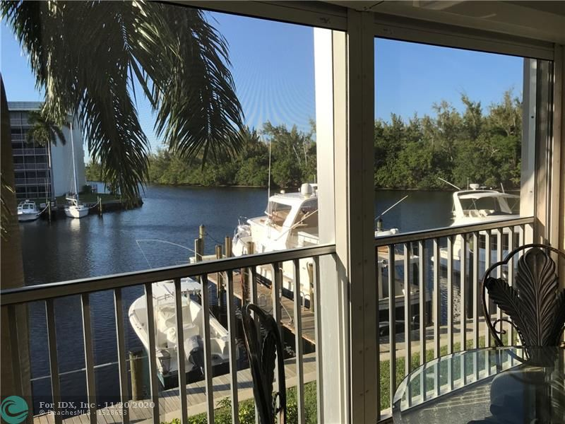 This gorgeous 2/2 condo with island, marina, & river views has been completely redone! Don't miss your chance to own one of the best views in Hillsboro Cove! Walk to the beach, restaurants, shopping, houses of worship,  & doctors. Enjoy your view from the oversize screened balcony with power hurricane shutters. Move right in as you won't have to remodel anything! Boat slips are on a first come, first serve basis at $2.75/ft/month. Have a jet ski or wave runner? There's even a spot for those at the same rate. This 55+ community has a beautiful resort style pool & remodeled clubhouse with lots of activities to meet your friendly neighbors. One covered parking spot with plenty of guest parking. You'll love this location! Two year waiting period to rent.