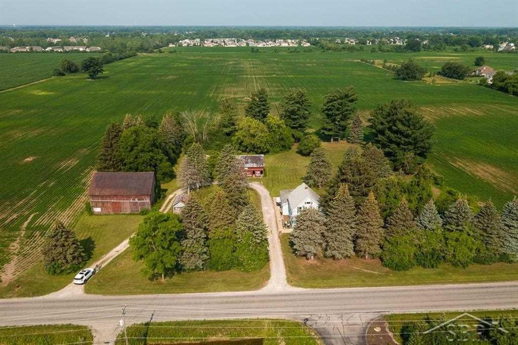 Prime Saginaw Township location for residential homes. Over 75. acres with 1086 ft. of frontage on Lawndale Rd., between McCarty and Shattuck, with water, sewer, and gas available. Farmhouse and barns included. Appointment is necessary to walk property or home.