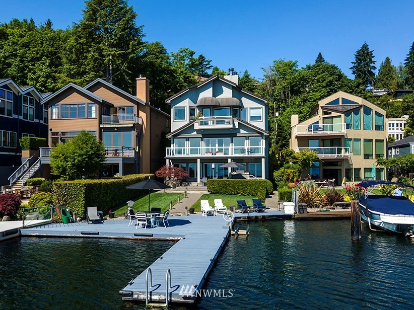 Lake Washington Waterfront! Enjoy Seafair & water activities from your own deck! Sweeping 180-degree views of Lake Washington, Mt Rainier, Cascades! Beautiful sunrises overlook city skyline from your spacious all-season deck. An entertainer's delight w/expansive views & inviting indoor/outdoor living spaces. A dream master suite upstairs w/gas FP, fabulous walk-in closet, coffee/wet bar, built-ins throughout. The updated kitchen has high-end appliances, granite ctrs. The family room features full bar, dishwasher, refrigerator, gas FP. Walk out to patio/yard/50' dock to enjoy lakeside activities. This meticulously maintained home offers spacious living areas, quality features & finishes throughout. A rare opportunity to live on the water!