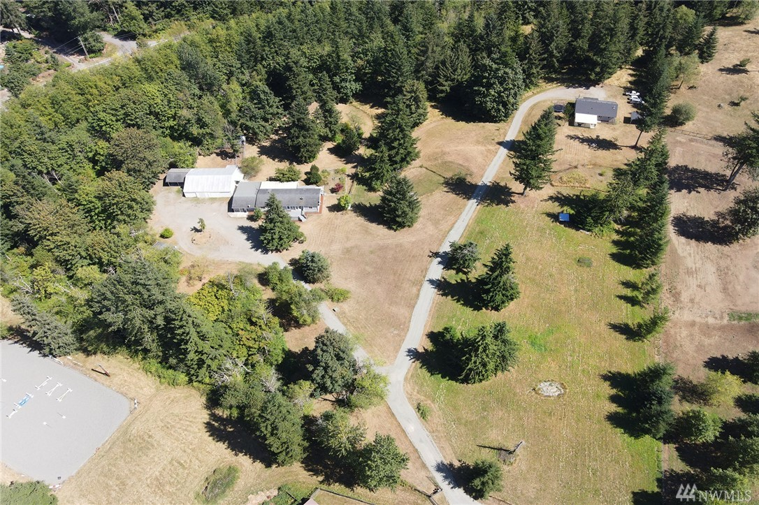 Peace & tranquility on 8.64 acres! Hobby farm, equestrian dreams, Airbnb or multi-gen housing. Beyond the gate you will find 2 homes, Studio, 40'x48' garage/shop. Beautifully cared for main home w/3bd/2ba, big kitchen, new carpet & paint. Second hm 3bd/2ba. Versatile studio has a full kitchen/utility. Addtl bldgs. 2 wells. Gated entry, pasture area, chicken coop, hog pen, dog run, dry feed storage-just bring your overalls & livestock! Cash only Buyers. Does not qualify for traditional lending.