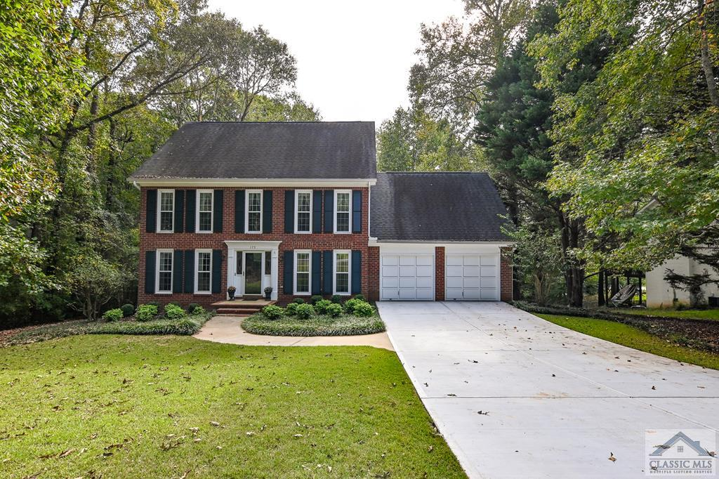 Wonderful home in McNutt's Creek subdivision, Timothy Road school district! This three sided brick (the fourth/back side is half brick, half siding), 3 story Colonial-style home is truly a Clarke county gem and is located on the west side of Athens in close proximity to everything Athens has to offer! The private lot showcases a beautiful back yard with numerous trees and shrubs; you can enjoy this gorgeous view from the large, private, wood-framed, screened-in porch perched above a shaded, walk-out patio directly off the unfinished basement. This is a custom built home built with the highest standards with extensive space and growth potential waiting for you in the spacious unfinished basement! As you walk in the front door, you will see 2 large, clear decorative glass windows located on either side of the door and a hallway leading to the half-bath and on into the kitchen. To your left, you will see a nice sized sitting room that connects to the cozy living room boasting a brick fireplace encased by built-in bookshelves. The living room connects to the spacious kitchen and features granite counter tops, stainless steel appliances and a lovely window over the sink, looking out onto the spacious screened in porch. Another great feature is the eat-in kitchen area surrounded by a beautiful bay window overlooking the inviting backyard landscape. Directly next to the bay window is a door leading outside to the uncovered, wooden back deck. Leading out of the eat-in kitchen space is the large laundry room with custom cabinetry above the washer/dryer space and a nice storage space. As you head upstairs and turn left, the huge owner's suite features a grand walk-in closet and several windows overlooking the back yard. Directly off the owner's suite is a spacious owner's bathroom complete with a large jacuzzi-style tub, a glass-door shower and a double-sink vanity. As you exit the owner's suite to the remainder of the second floor, there is a full bath flanked by 3 more bedr