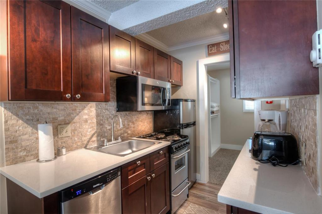 Clean and modern kitchen with stainless appliances.
