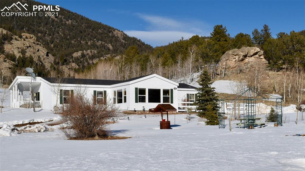 Welcome to your Authentic Colorado Lifestyle! Pride of original ownership is evident throughout! Beautiful ranch-style home with amazing 360 views w/ rock outcroppings. Tiara subdivision is tucked away just off paved roads where you will enjoy views of 39 Mile Mountain, 11 Mile Reservoir, the Sangre de Cristos Range, Collegiate Peaks & Spinney Mountain as you make your way to your cozy mountain retreat! You will love the warm and inviting sunroom! New carpet throughout! Welcome Home!