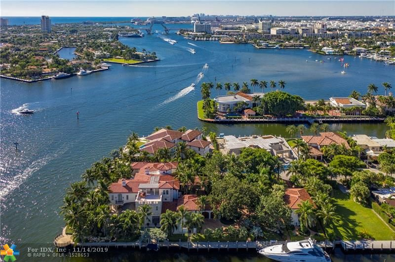 Opulent & regal point lot estate w/437' of deep water frontage & 170'+ full service, protected mega yacht dockage. Quick & easy ocean access. This is truly one of the most spectacular properties in all of South Florida w/astounding views. You are welcomed by rolling lawns & huge shade trees which grace this extraordinary property as you drive thru the gate to the porte-cochere. Fully equipped chef's kitchen, formal dining room, stately master suite w/full marble bath. Exquisite details and the finest finishes include magnificent limestone floors, beamed ceilings, spectacular wine cellar, elevator & fireplace. Located in the historic Rio Vista neighborhood, conveniently located to downtown Fort Lauderdale, shopping, fine dining, nightlife, air & sea ports & major highways.