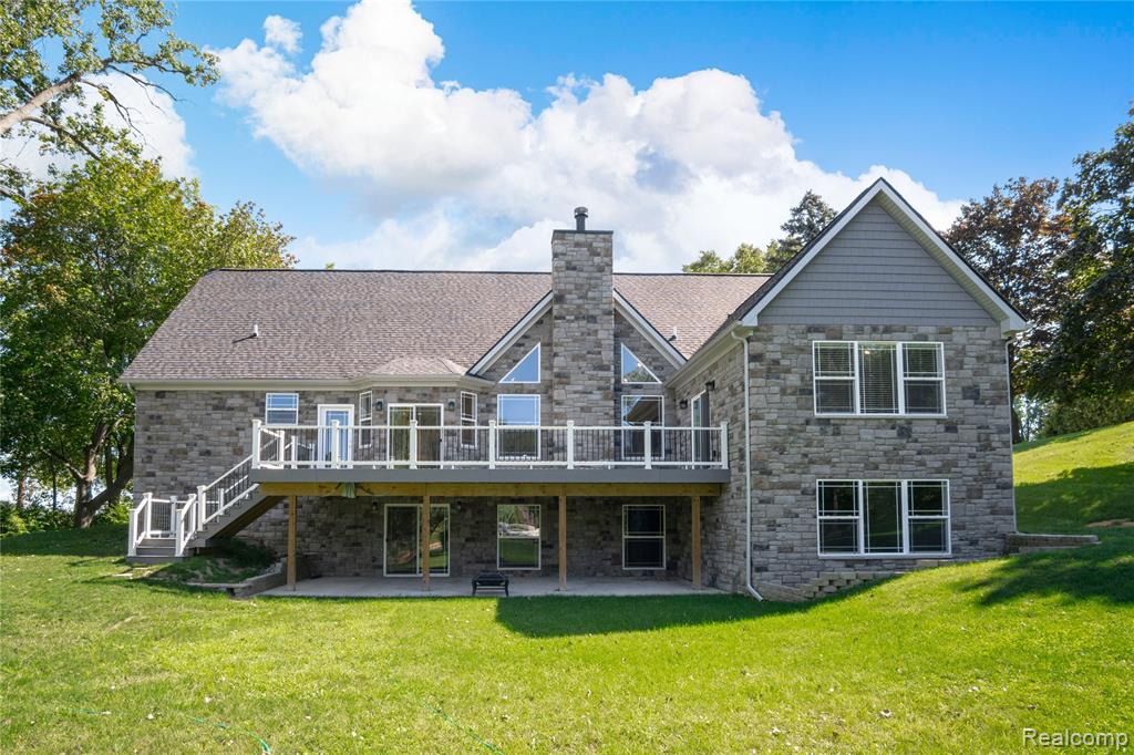 Stunning Custom Waterfront Ranch boasting 193' of frontage on Marl Lake connecting to Silver Lake - soak in all this lakefront property has to offer like beautiful sunset views from the 14' x 34' Trex deck & a private dock for access to both lakes to enjoy boating, fishing & more. You are welcomed into this home w/glowing hardwood cherry floors, soaring Cathedral ceilings & an open floor plan perfect for entertaining! Great room features a natural fireplace w/floor to ceiling ledge-rock surround  - perfect for chilly winter nights, kitchen has leather-finished granite, KraftMaid cabinets & stainless steel appliances. Spacious master suite w/walk-in closet & full bath includes both a stand-in shower & 2 person jacuzzi tub. Walkout basement boasts over 1,875 sq. ft. ready to be finished with pre-plumbing done for another bathroom and kitchenette, and also separate areas designed for a walk-in wine cellar and gun vault. This home is better than brand new - come see for yourself.