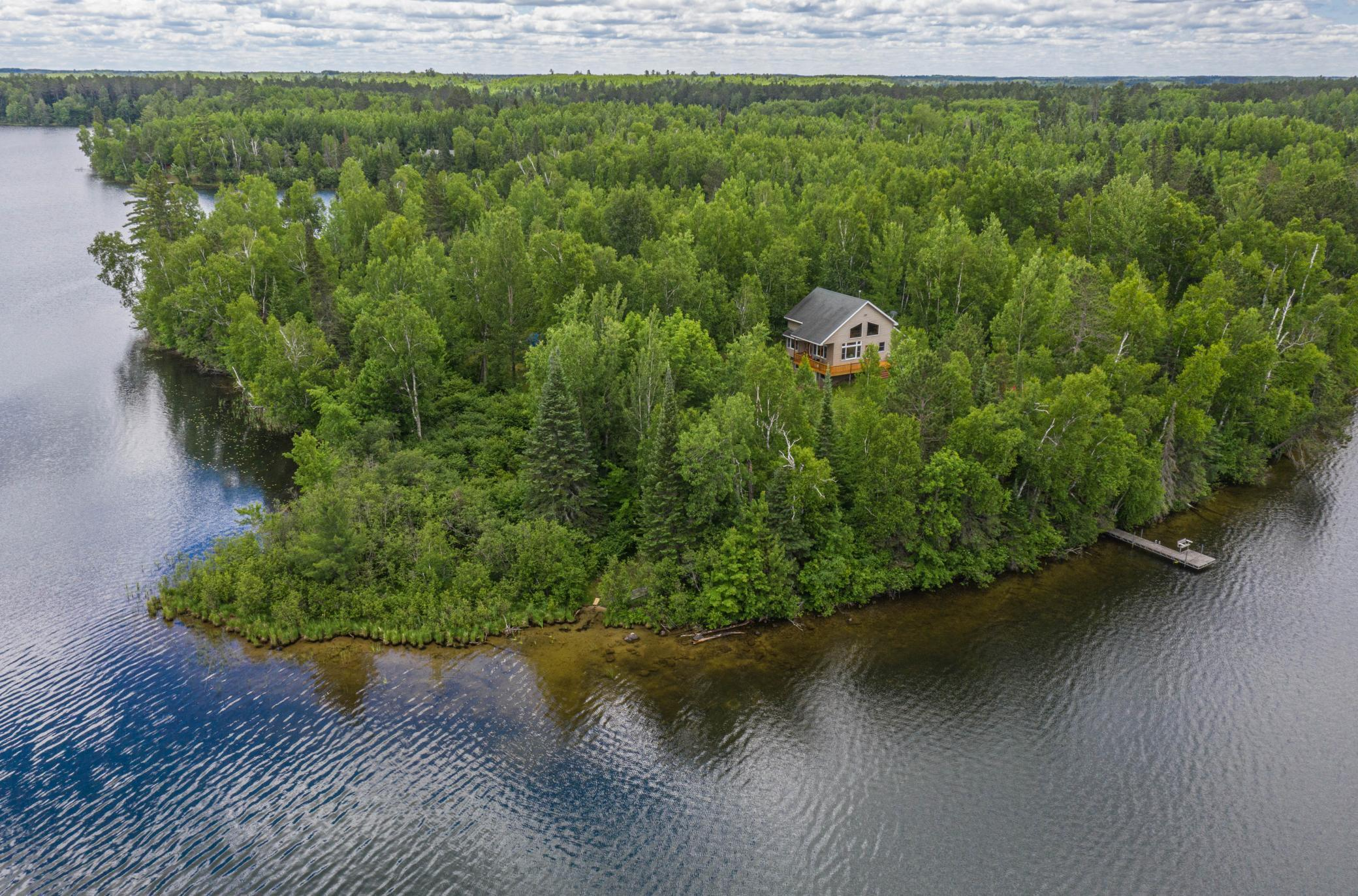 Looking for a retreat that's off the backroads? This remote 3brm year-around home could be just the ticket. Wooded point with 660 feet of lakeshore, a swim area and not a neighbor in sight from the home. Open floor plan, loft, main floor laundry and newly finished walk out basement. Other features include a double sided fireplace, vaulted ceiling, attached garage, newly refinished deck and compliant septic system.  This is a terrific property in a fantastic year-around recreation area. Don't forget to check out the 3D tour.