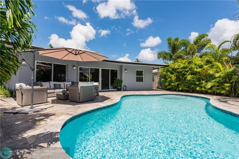 STUNNING PRIVATE CONTEMPORARY WATERFRONT POOL HOME IN EAST WILTON MANORS...SPECTACULAR VIEWS DOWN THE CANAL!..THIS HOME WAS BUILT TO ENTERTAIN, OPEN CONCEPT LIVING, MODERN PORCELAIN FLOORS THROUGHOUT AND CUSTOM DESIGNER FINISHES...LARGE KITCHEN BOASTS WHITE CABINETRY WITH BRUSHED SS PULLS, LIGHT GRAY QUARTZ COUNTER-TOPS, SAMSUNG'S GRAPHITE SERIES APPLIANCE SUITE, WINE-COOLER...ULTRA MODERN BATHS, MASTER W/ EN-SUITE FEATURES DOUBLE SINKS, JACUZZI TUB, & SEPARATE SHOWER. HOMEOWNERS HAVE TAKEN IT TO THE NEXT LEVEL WITH A MASSIVE NEW CIRCULAR PAVER DRIVEWAY, COMPLETELY REFINISHED POOL INC. DIAMONDBRITE, NEW TILE, MARBLE POOL DECK, WALKWAYS, POOL HEATER & PRIVATE DOCK..2 NEWER A/C SYSTEMS, ALL ELEC SERVICE UPGRADES, LED RECESSED LIGHTING, HURRICANE IMPACT W & D...STEEL ROOF & NEW GUTTERS...