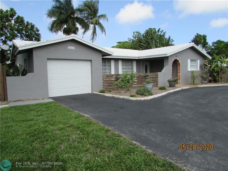 This adorable home is in a quite neighborhood in West Wilton Manors. Split bedroom plan with pergo and tile flooring, The kitchen has stainless steel appliances and is open to the living room and dining room. Large screened in porch, huge backyard completely fenced in with lots of landscaping and room for a pool. One car garage with a hurricane impact door. Circular driveway. New A/C installed in 2017. Cement tile roof.