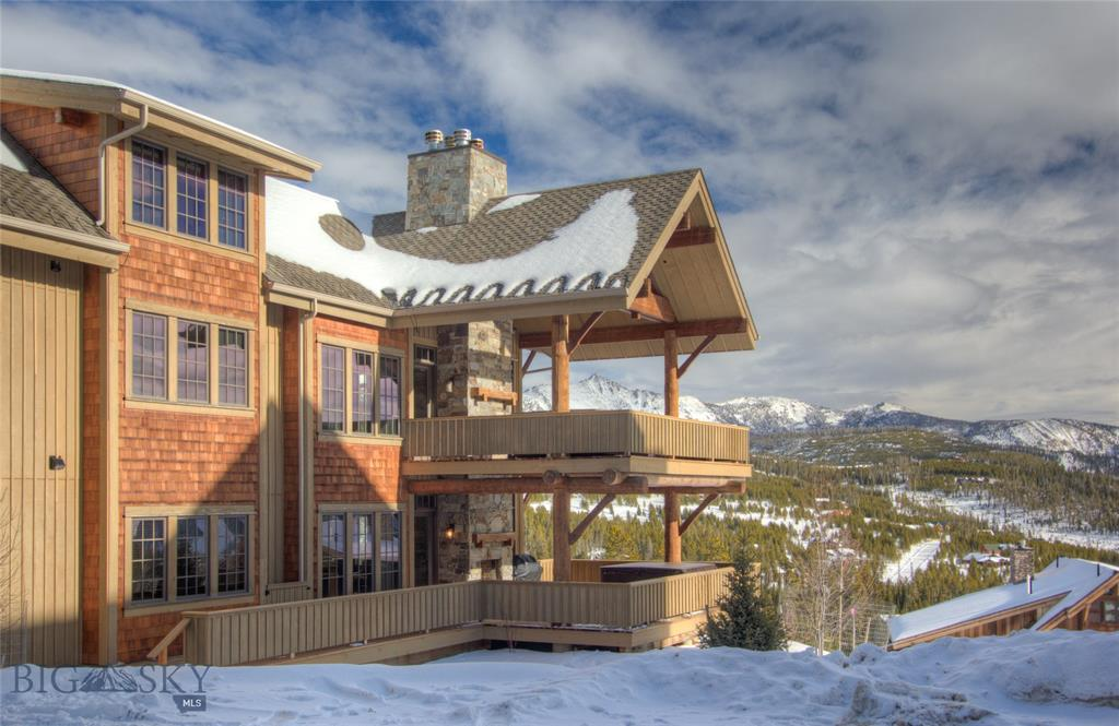 Premier ski-in, ski-out Luxury Suite in the most recently completed building (2014 vs 2006), turn key, and move in ready! Enjoy this 5 bedrooms (3 king suites, 2 dedicated bunk rooms), 5.5 baths, indoor and outdoor fireplace, commercial grade built in boot and glove dryers and Spacious outdoor hot tub where you can enjoy the coziness of the outdoor fireplace simultaneously. The open floorplan is perfect for family gatherings, with commercial grade appliances and slab granite counter tops. This 5 bedroom Luxury Suite is one of only four residences in this quiet building, well appointed communal game room and private lockers for each unit, heated sidewalks, attached heated garage, and is the perfect ski-in, ski-out condo with direct access to Moonlight Basin, and Big Sky Resort.
