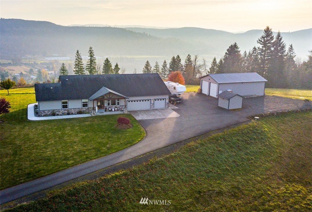 Amazing 360-degree mountain & valley views on 5+ acres!   Beautiful hilltop home, 9' ceilings 30x48 shop and more!   3280 SF includes 880SF attached ADU/Apartment w/2 heating systems, washer-dryer hookup and independent living all on one wheel-chair friendly level.  Main house is 2.25 baths + bonus room wired for media, office +3BR!  Master BR has 2-walk in closets & luxurious bathroom.  ADU is 880 SF w/ low-step shower, walk-in closet, full kitchen & washer-dryer adjacent to the main laundry room.  High quality doors, cabinets & trim throughout.  BBQ'g as you view the valley will make you feel like you are in some kind of dream; photos paint a better picture than words can!  Just 23.5-minutes off I-5, midway between Portland and Seattle!