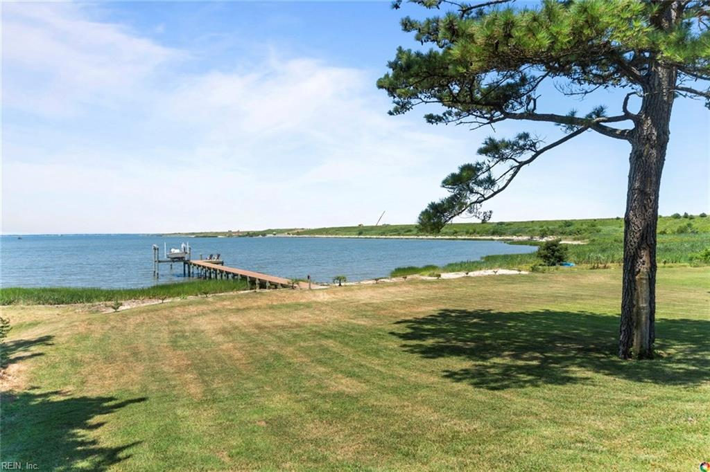 Don't miss out on your chance to see this waterfront stunner that impresses with huge front and backyards, gorgeous water views, tons of driveway space, a long dock with a boat lift, and so much more! The sunroom with a built in bar and wraparound waterfront windows opens up into a warm and cozy family room off of the kitchen, making this home an ideal spot for entertaining or family time. The spacious master is complemented by an updated bathroom with a waterfall shower. This charming waterfront ranch is sure to wow you!