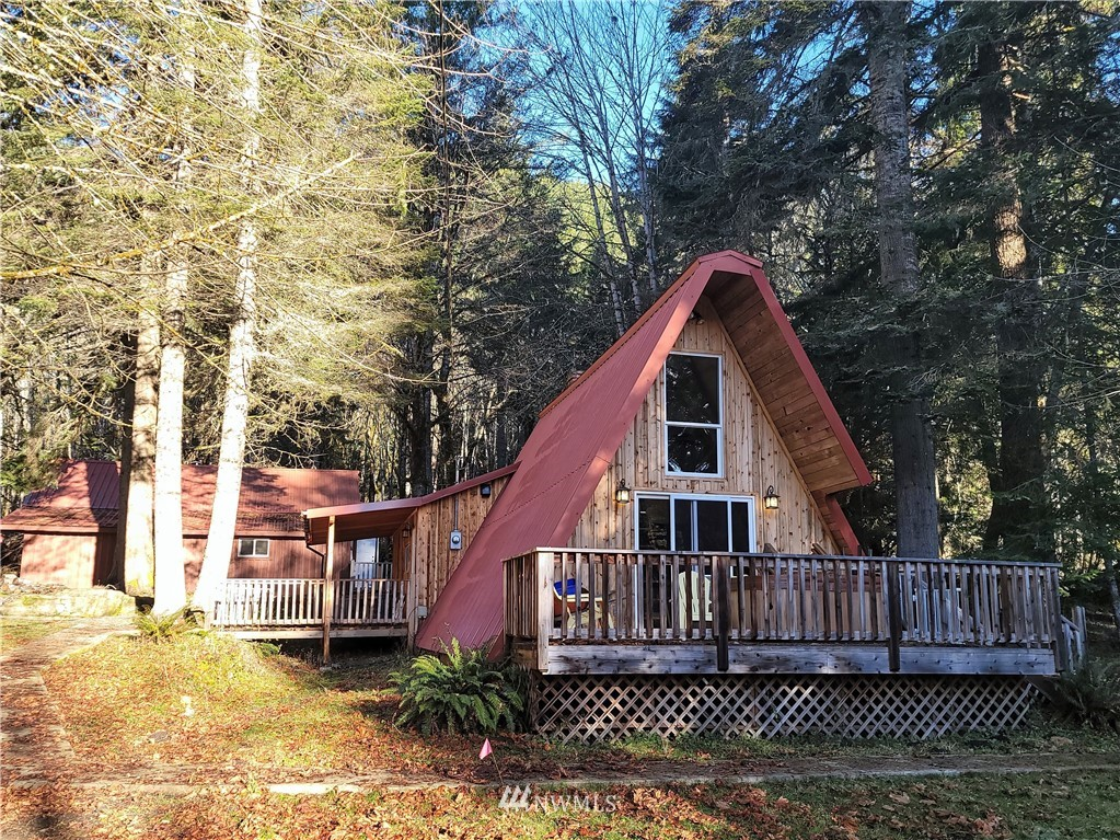 Beautiful Red Wood A frame cabin at the base of  Mount Rainier on 1 Acre with big shop, This beautiful cabin would make a wonderful get away or rental cabin, Metal roof, Loft, Wood burning fireplace, Hot tub, Amazing fire pit all on 1 acre of secluded property.