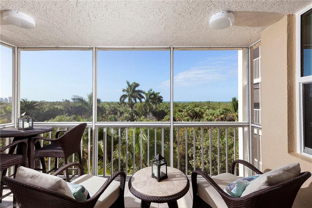 Conveniently located in the gated village of Crown Colony at Pelican Bay, this St Marissa residence is a treetop treasure with ribbon views of the Gulf of Mexico. It is perfectly sited on the 4th floor, embraced by the sun and close to nature and the beauty of the protected estuary. This residence has two bedrooms, a space for lounging as a den or dining off the kitchen and a corner lanai enclosed with impact glass for additional living space. Use it for dining or a workspace tucked away amongst the tropical setting. The St Marissa is undergoing installation of impact glass without a special assessment. St Marissa owners may have 1 small dog or cat, as well as 1 or 2 birds in residence. A great location within walking distance to the Pelican Bay berm, tram station and beach. This condominium is located in the sought-after community of Pelican Bay, offering an amenity-rich lifestyle package that includes private beach access, private beach clubs, an extensive fitness facility and tennis.
