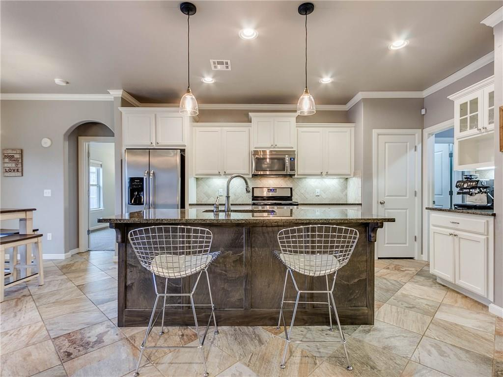 Immaculate, pristine condition Home built in 2015 By Beacon Homes has it all! With 1652 square feet, there are 3 Beds, 2 Baths, plus Study, Living Room with Fireplace, Dining Room, Oversized Windows, and Open Floor Plan you will love! In the Kitchen,  there is a Huge Island/Breakfast Bar, Pantry, Stainless Steel Appliances and is just beautiful! Master Suite is spacious, with his/hers Vanities, Walk-in Shower, Bath Tub, Huge Walk-in Master Closet that connects to the Laundry Room - so convenient! The Large Backyard has a Covered Patio and a Sprinkler System! The Grove is a fantastic Community with: 3 Swimming Pools, 2 Clubhouses, 2 Fitness Centers, Paved Walking/Jogging Trails, Treehouse Park, Soccer Field, Basketball Court, Stocked Lakes & Ponds, and an onsite Elementary School in Deer Creek A+ Schools! It doesn't get any better than this!