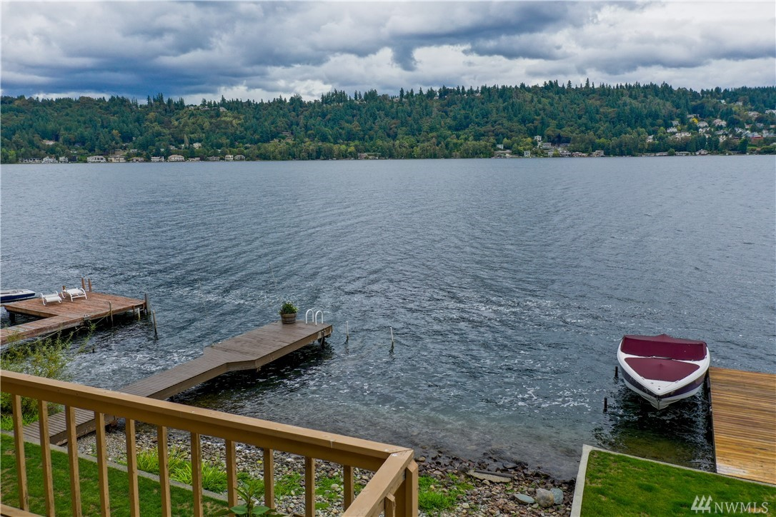 Rare waterfront opportunity on Lake Sammamish! Lots of windows let in an abundance of light & frame the beautiful PNW sunrises. Endless views of Lake Samm, Mt Rainier & moon rises in the late summer. Outdoor living is endless: a deck extends entire width of main floor, stairs lead down to a partially covered patio, flat 50' grass yard w/veg gardens, fire pit & direct access to private dock w/boat lift. Rejuvenate in your own steam rm. Electric tram takes you to a peaceful sanctuary on the lake.