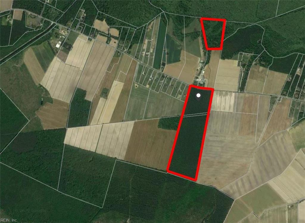 Rare opportunity to purchase a large tract of wooded property sitting between 2 agriculture plots. This property sits between the Chesapeake bypass and the Hwy17 which allows for easy access to Military Bases, beaches and shopping.This property contains 2 parcels 90+- acres (g-pin 1050000000030) and 26+- acres  (g-pin 1050000000200). The 90 acre parcel has the potential for homesites, timber investment, riding trails, gentleman's farm as well a prime area for hunting.The 26 acre tract does sit across the street and buyer will have to establish ingress and egress. Property's convey as -is, where is.