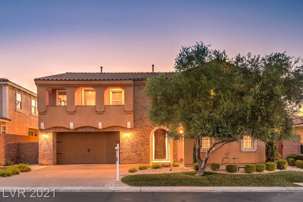 This exquisite gated community home with over 4,400 square feet of flexible living space in Lake Las Vegas features beautiful French doors that lead out to a terrace with views of the strip and an uninhabited green golf course that will take your breath away. The primary bedroom exudes charm with its balcony, extra large walk-in closet, and beautiful bathroom with double sinks, walk-in shower, and makeup vanity. The chef's kitchen will be the envy of your friends with opalescent granite counter tops, stove top with oven, double convection oven, over-sized refrigerator, and wine fridge. Don't miss out on this one!