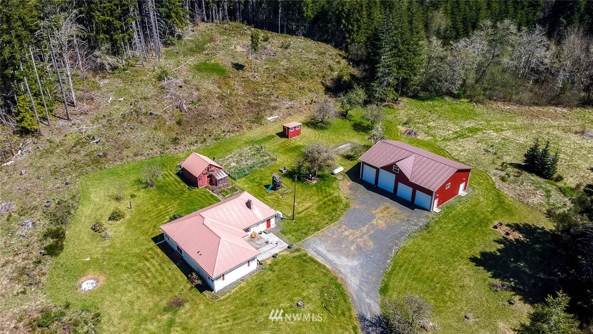 Look no further, a peaceful, private home & acreage surrounded by 100's of acres of private & state timberland. This is a shy 2000 sq. ft. 3BR 1.75 BA single level home situated on 7.48 acres that includes a 55'x40' four bay shop with over sized doors. Other amenities include  beautiful red fir flooring throughout, a custom kitchen with upper scale appliances. Large comfortable living & dining rooms with a wood burning brick fireplace. Charming master bedroom with a spacious master bath, & 2 additional large bedrooms. Over sized laundry & mudroom with a separate entrance. Outside there are large decks, outbuildings, a back up generator & the shop. The land has the perfect combination of woods & meadows, a lot to like here, come and look.