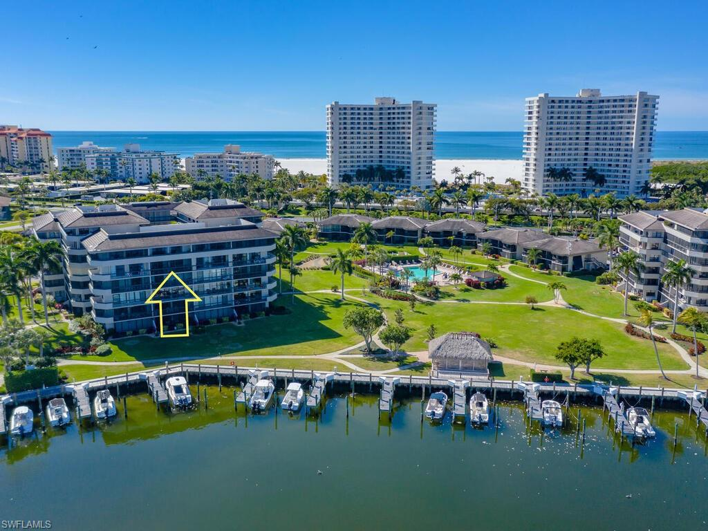 Paradise awaits you at this 5th Floor, FRONT FACING, 2 Bedroom/ 2 Bathroom condo in the gated community of South Seas Club. Enjoy unobstructed and expansive views of Clam Bay! This UPDATED condo is being sold furnished and has many UPGRADES throughout including ceramic plank tile flooring and carpeted bedrooms, crown molding in the living room, full size washer/dryer, granite kitchen countertops, Oak cabinets, built in wine rack, and stainless steal appliances. This gate-guarded community offers many amenities that include beach access, boating (slips available for lease), biking/jogging, pickle ball, tennis, pool and tropical grounds.
