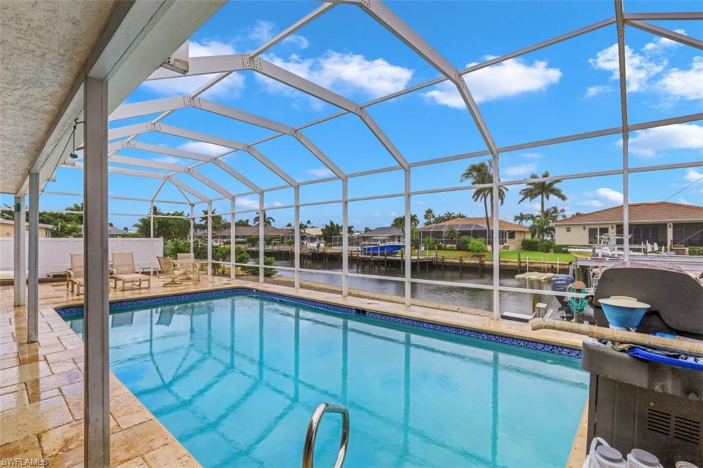 H.16475 - This nicely updated, waterfront home is a boaters dream home!  The home boasts a nice addition, spacious pool, new seawall (2012), quick indirect access to the Marco River, two lifts (8,000 lbs and 12,000 lbs (2012)), spacious water frontage (149'), expansive outdoor entertaining areas, and freshly painted inside and out.  Split floor plan with master suite on one side of home and 2 guest bedrooms on the other.   Open kitchen and living room overlooking spacious outdoor entertaining for large gatherings of family and friends.  The perfect move-in, r3eady home for the boater looking for quick access to the Marco River with one of his many water toys.