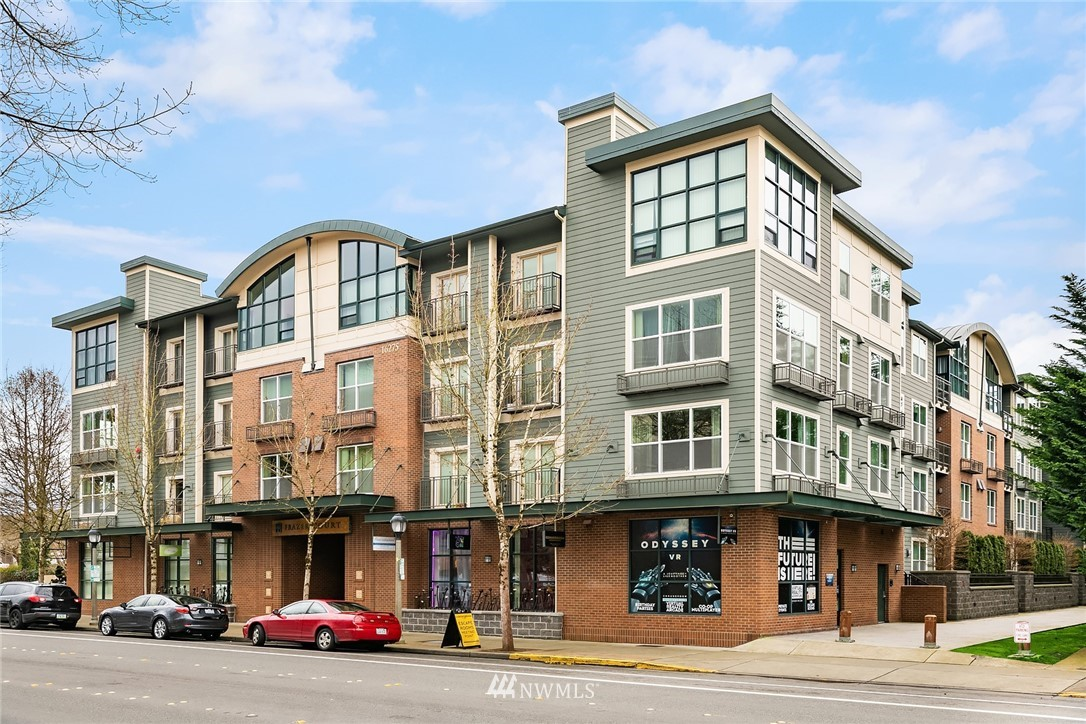 Stunning remodeled 2 bdr/2 bath condo in the heart of DT Redmond.  Bright SE corner unit w territorial views from the floor to ceiling windows. Spacious open floor plan living with soaring ceilings, fireplace & tile surround TV mantle. Modern kitchen with newer stainless steel appliances and breakfast bar. Hardwood bamboo floors throughout. Master with walk-in closet and bath. 2nd bedroom with bath and built in deck/computer alcove. Perfect for WFH. Secured entry, elevator, secured underground parking, common courtyard with BBQ and garden. Walk to library, park & Ride, trails and shopping! Over $50k upgrades! NO rental cap!