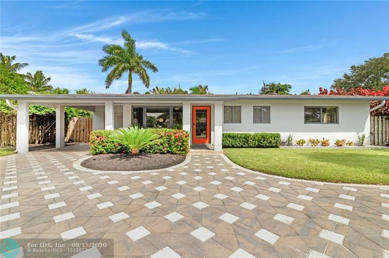 Welcome to this stylishly renovated modern home in Central Wilton Manors. Perfectly updated while maintaining the mid-century style of it's past.  Sparkling terrazzo floors though out.  A wonderful flow for entertaining both indoors and out.  Features include Quartz Countertop, custom cabinets, Completely updated baths, closet organizers, and impact windows.  Ample room for a 24x12 Pool (plans available).  Newer smart irrigation system on well.  A/C less than one year. Enjoy the sunsets in your spa.  Just a short walk to world famous Wilton Drive.  Minutes to downtown Fort Lauderdale and major freeways.