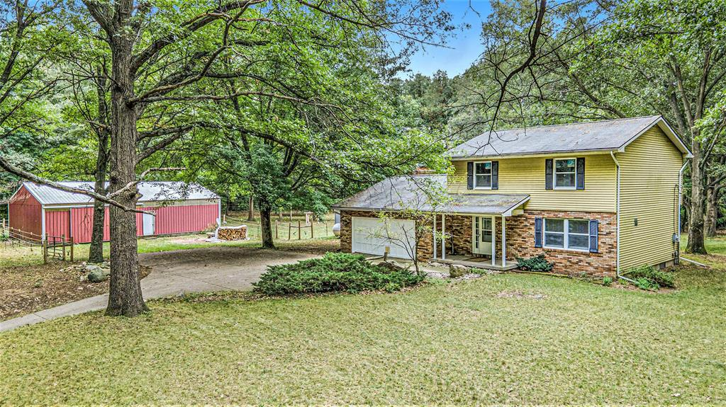 Beautiful, private, wooded hilltop setting for this spacious 4 bdrm, 2.5 bath home w/in ground pool (needs a liner & other attention), 46x28 polebarn w/sand floor & horse stalls! Just minutes from the Waterloo Recreation Area, w/more than 20,000 acres offering camping, numerous lakes, beaches, trails & more- if you love nature & tranquility, this setting & home is perfect for you! Main floor features large living room, formal dining, family room w/fireplace & 1/2bath. 2nd floor features 4 bedrooms, 2full baths (including the master), large closets & views of the property! Large deck overlooking fenced backyard, plus a fenced area around the pool & also set up w/ separate fenced & covered dog kennel. Good, solid home that has new flooring, paint, furnace & other updates to suit your needs.