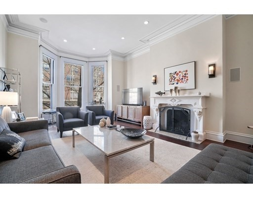 Beautiful single-family townhouse in the heart of Back Bay. Upon opening the front door, you are welcomed into a spacious foyer featuring an exceptional grand staircase, which opens to a large family room with a full bar. The second floor brings you to an updated kitchen, with an open-concept dining area and high ceilings. Oversized bay windows give you a view to Beacon Street. The south facing master bedroom includes a fireplace and modern bathroom with a luxurious soaking tube. A large bathroom is located on the top floor. The garden level is a full one-bedroom guest suite/apartment, with a private entrance. A private patio and one car, detached garage are other amenities. Numerous updates have been completed over the last few years, including new wood floors throughout and HVAC. All of the bathrooms were renovated in 2017 and there are also two separate laundry areas (top and bottom floor).