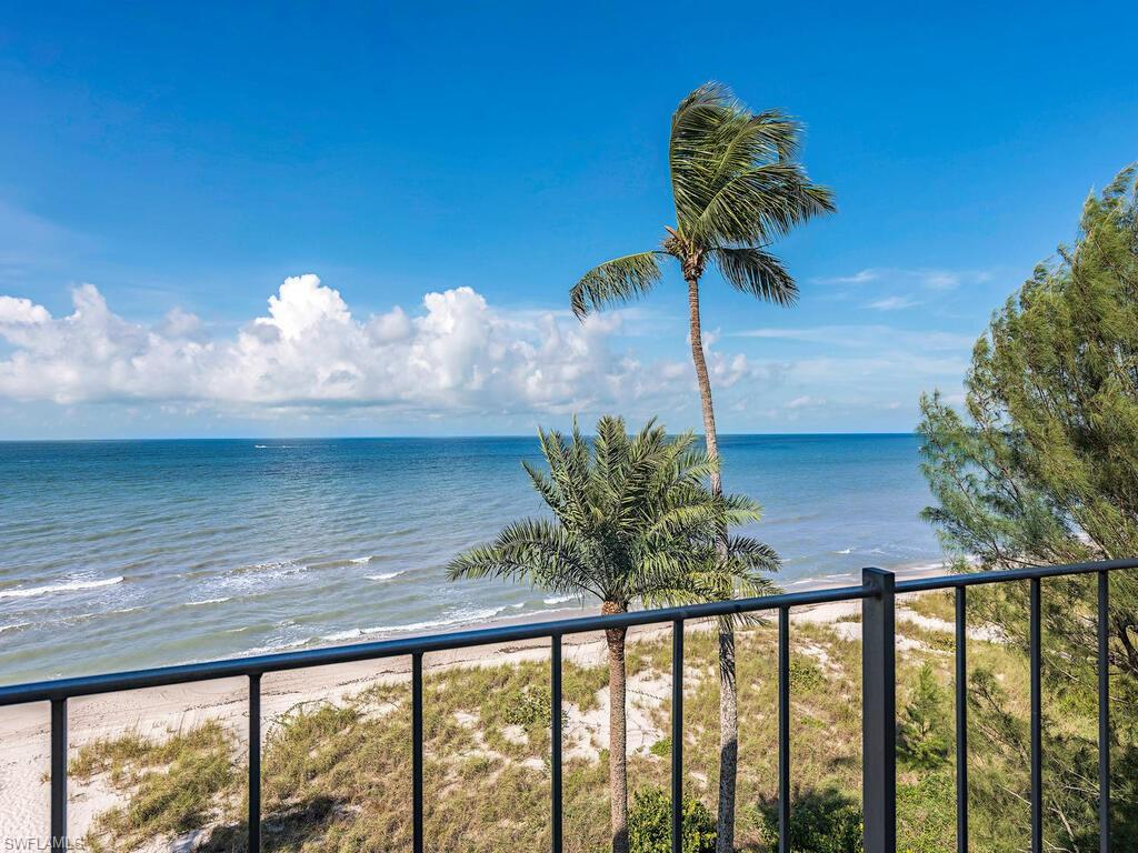 Enjoy direct Gulf front living - right on the beach. This special residence is an end unit with three exposures, due west for expansive Gulf of Mexico views, north for city lights at night and east with peeks of the Bay across the Boulevard. Move-in ready with updates including AC, storm rated windows, new baths, electric panel, paint and kitchen opened up with breakfast bar.New roller shades on all the windows, electric storm shutter on the sliding glass door and a remote controlled electric shade.  The Carriage Club is impeccably maintained, with a pool, assigned carport parking, extra storage, secured lobby and experienced on-site managers. Just minutes to Old Naples for shopping and dining. Exterior painted, new roof and cooling tower replaced 2017.